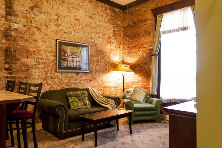 Seattle Comic Con Beautiful exposed brick give this apartment a homey feel.
