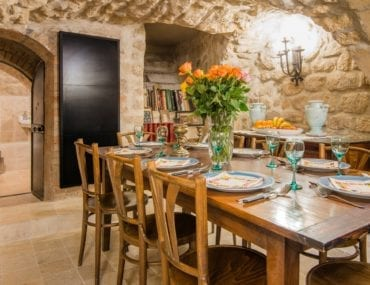 Medieval style kitchen with stone walls and rounded doorways