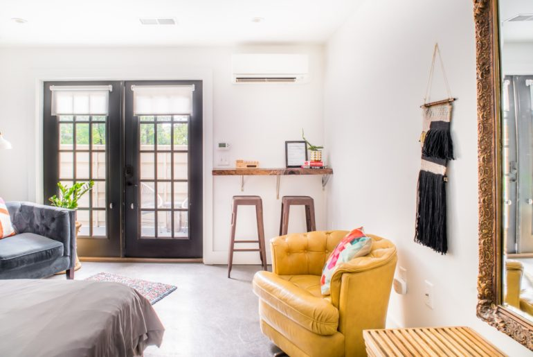 The living space has double doors that open up to the private deck