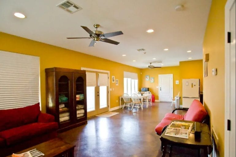 The studio is spacious and welcoming with bright yellow walls and comfy futons.