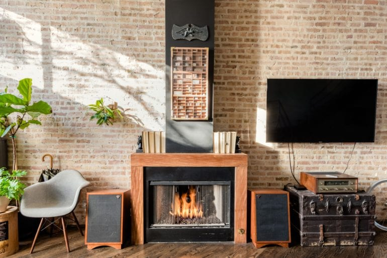 The indoor fireplace adds a level of coziness to the living room