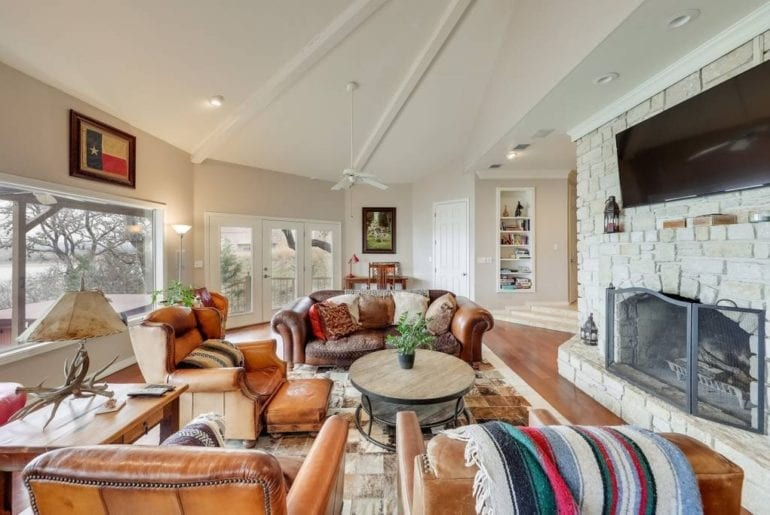 """The living room has a fireplace, 70"""" television, and plenty of seating for the whole family"""