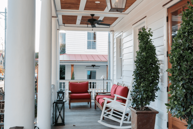One of the best Airbnb Charleston properties feature a sunny front porch to the historic manor