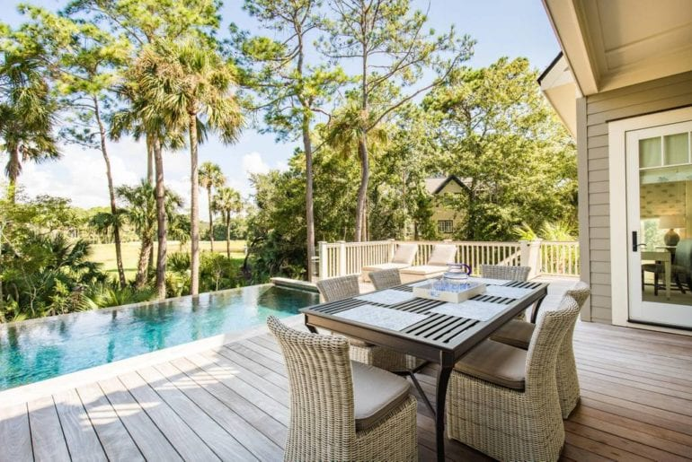 Beautiful patio and infinity pool overlook a Charleston golf course
