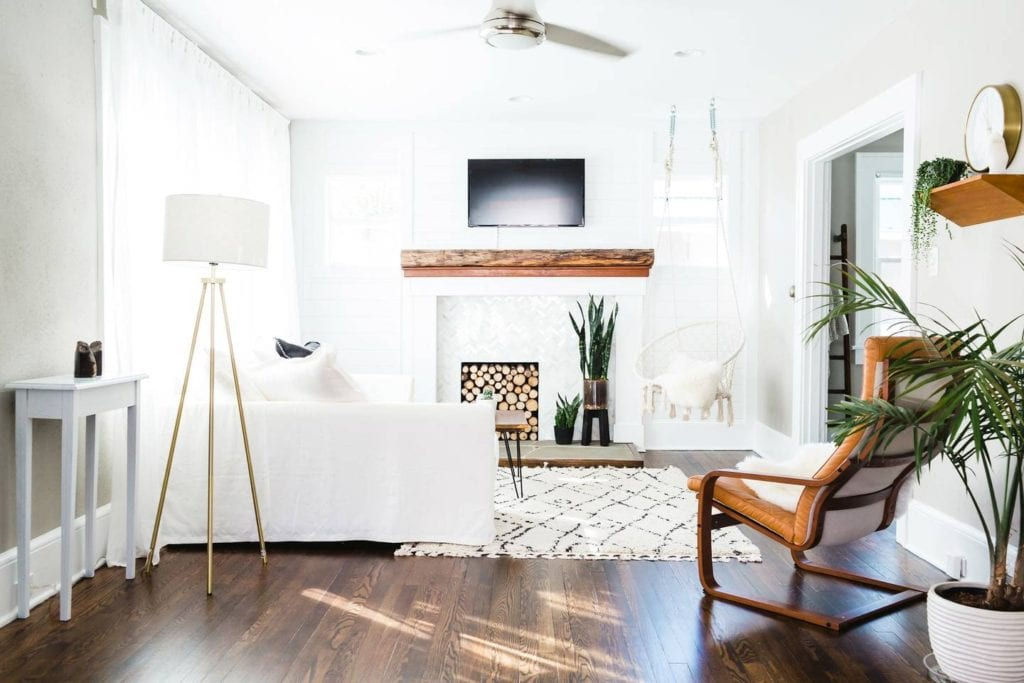 Bright, chic home featuring boho vibes, modern decorations, and a netted swing in the living room