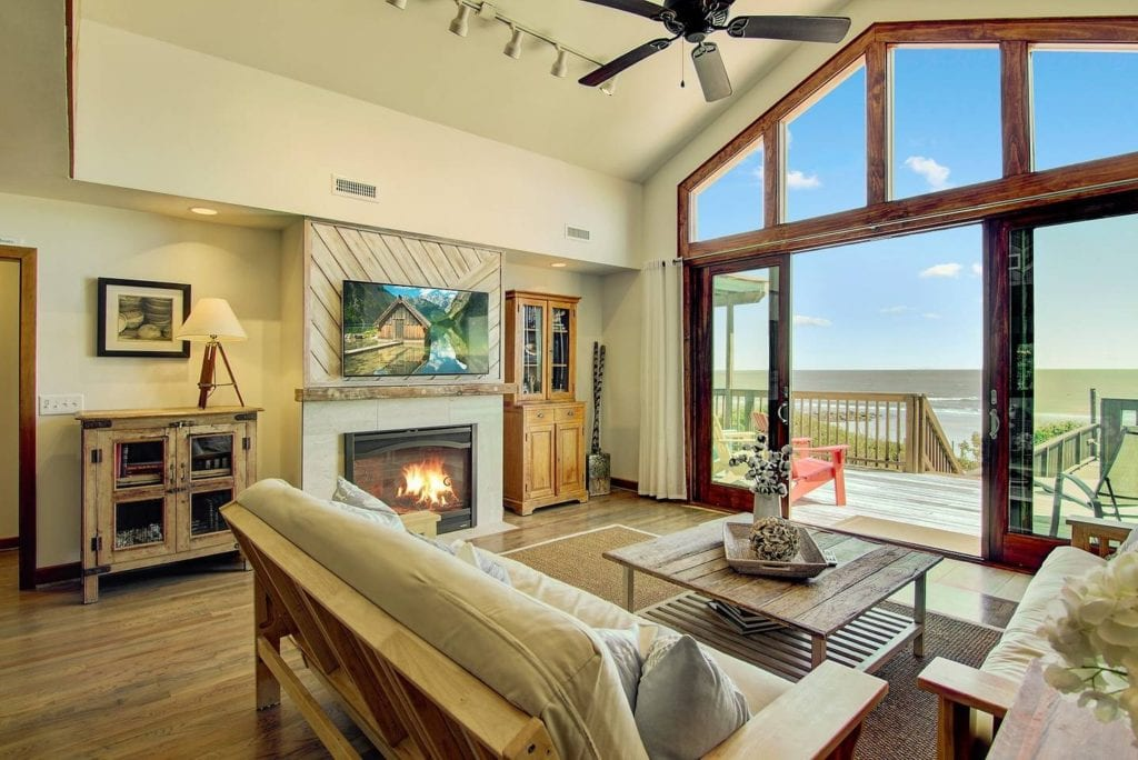 Floor to ceiling windows give this living room a beautiful view of the ocean