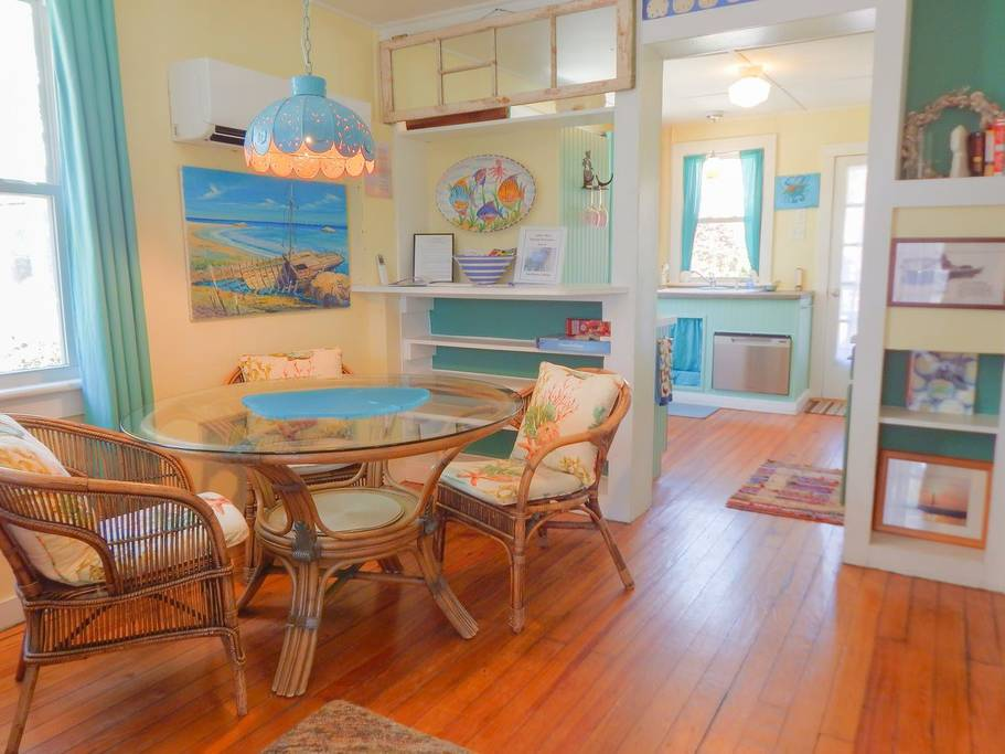 Vivid colors and patterns decorate the dining room in one of the three cottages from these Folly Beach vacation rentals