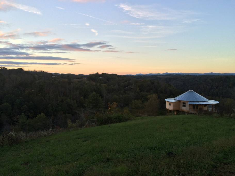Dusk outside of this round house in the mountains proves to be one of the most romantic airbnbs in Asheville