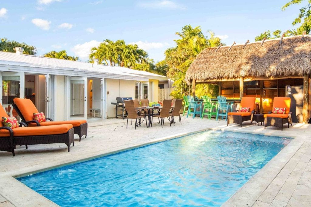 Sunny Key West Airbnb featuring in-ground pool and private tiki bar