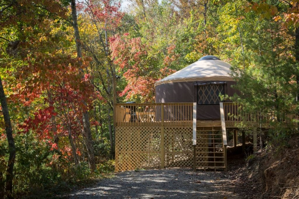 Outside view of a private yurt in an autumn forest