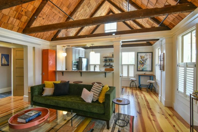 Warm-toned living room under high-vaulted ceilings at one of the best airbnb Charleston properties
