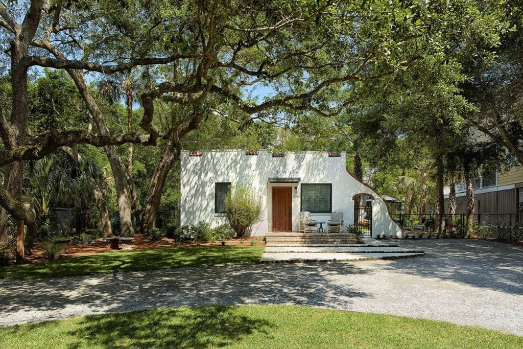 Cottage shaded by large oak trees is a great alternative to Folly Beach hotels