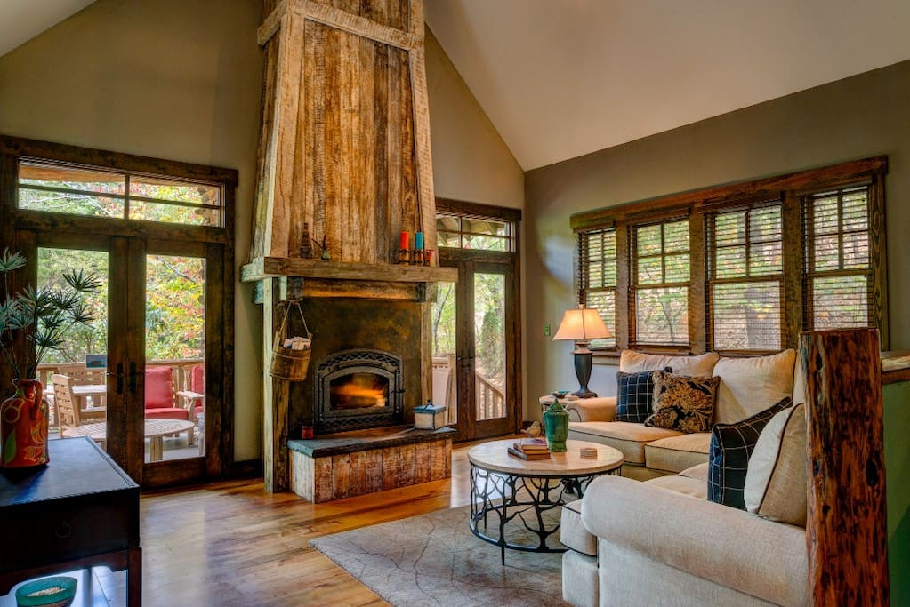 Living room of an Asheville rental featuring a gorgeous timbre-framed fireplace