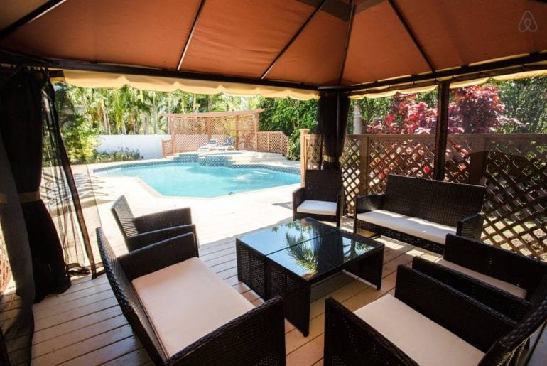 some decking around a pool in a West Palm Beach Airbnb