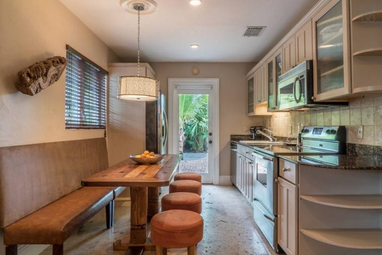 a kitchen space with dining area in an Airbnb vacation rental property in Florida
