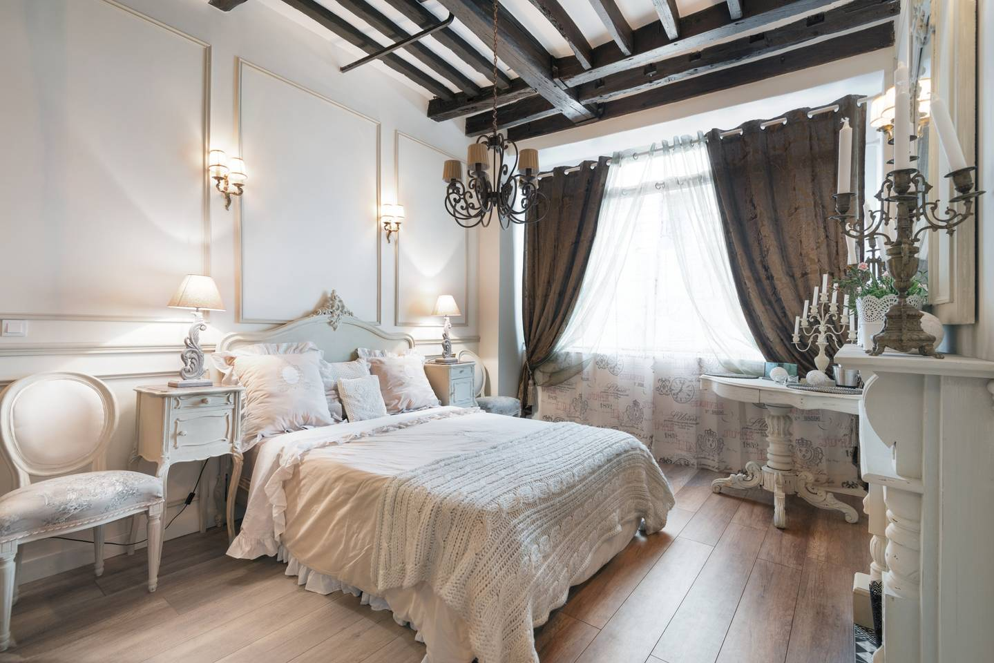 a bedroom with wood beams, perfect for romance