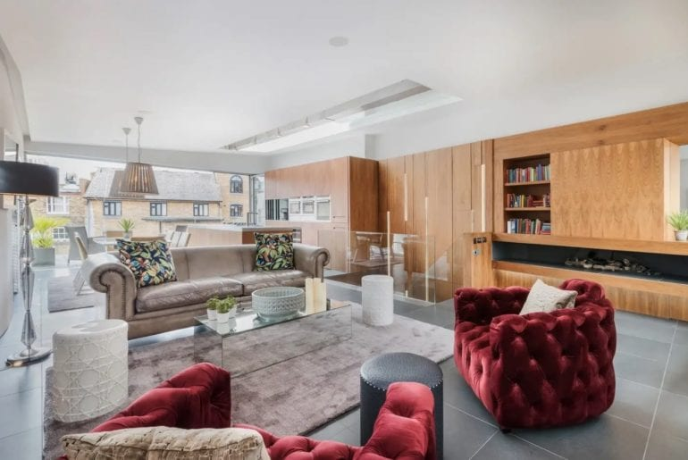 a large living area in a London Airbnb with a chic rug in the middle of the room