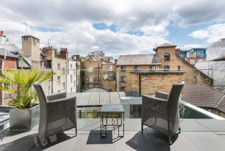 a balcony overlooking terraced houses in London