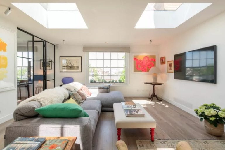 understated, colorful living room with large tv in London