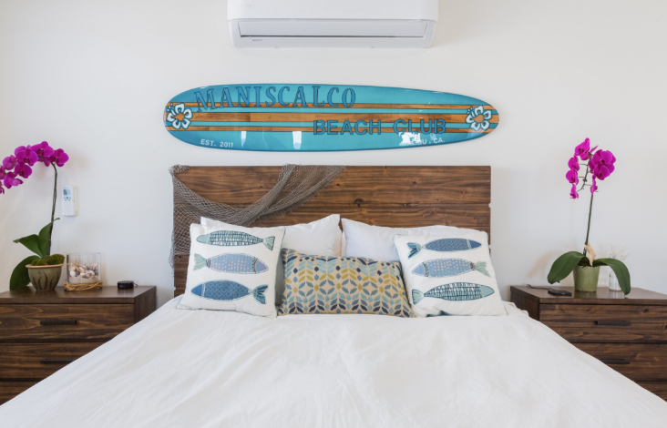 bedroom with surfboard above the headboard in Los Angeles