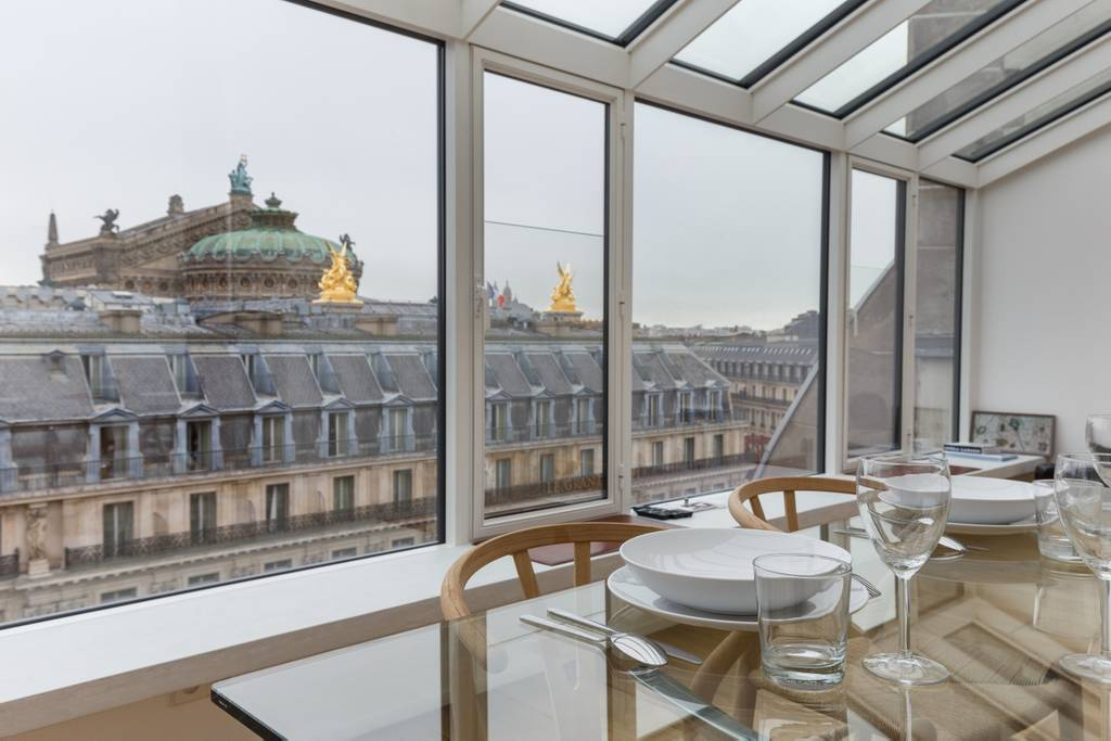 A romantic paris Airbnb with a view of a palace