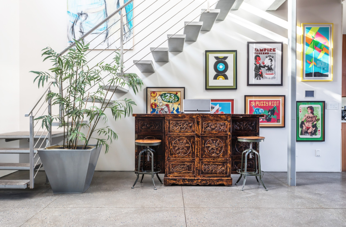 living area with plants and posters in Los Angeles