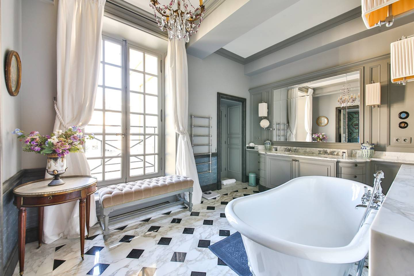 a bathroom with a stand alone tub in France's capital city!