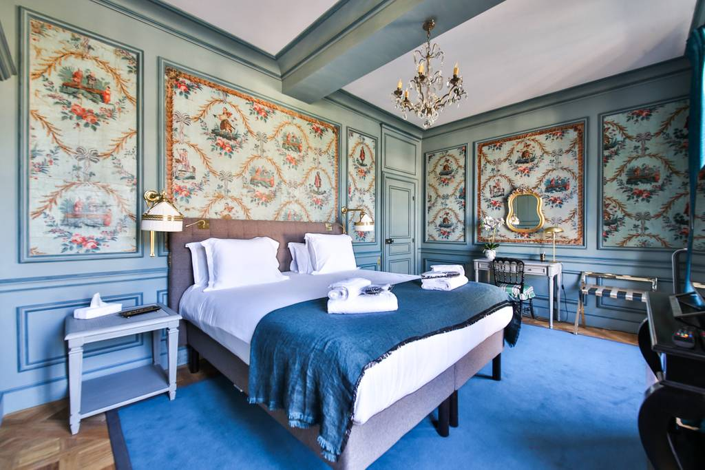 intricate panelling in the bedroom of a Paris home