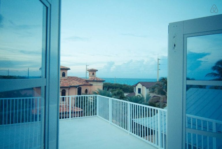 the view out of a window of some Spanish-style houses from an Airbnb in West Palm Beach