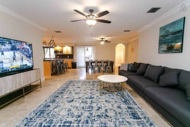an expansive living room with a blue rug and blue sofa in West Palm Beach