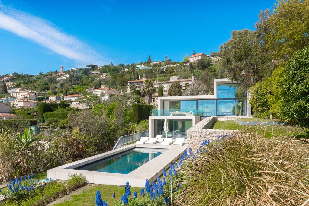 modern and minimalist home with view of mediterranean